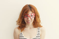 Superhero girl wearing mask with strawberries Stock Photo