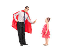 Superhero giving an ice cream to a little girl Royalty Free Stock Images