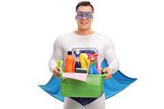 Superhero holding basket with cleaning products Royalty Free Stock Photography