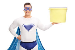 Superhero holding a big yellow bucket Stock Photos