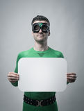 Superhero holding a blank sign Royalty Free Stock Image