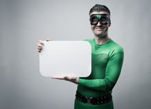Superhero holding a blank sign Stock Image
