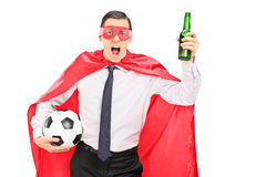 Superhero holding a football and cheering. Isolated on white background Royalty Free Stock Photography