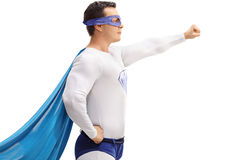 Superhero holding a gripped fist in the air Royalty Free Stock Image