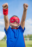 Superhero holding hands up and looking at the sun. Boy dressed in cape and mask holding hands up and looking at the sun royalty free stock photos