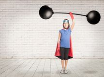 Superhero holding a heavy weight stock images