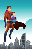 Superhero Holding a Little Girl Royalty Free Stock Photography