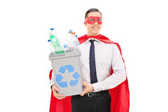 Superhero holding a recycle bin Stock Photo