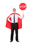Superhero holding a stop sign Royalty Free Stock Photo