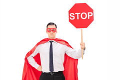 Superhero holding a stop sign Stock Photography