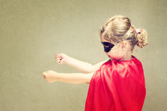 Superhero kid against blue sky background Royalty Free Stock Photos