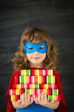 Superhero kid in class Royalty Free Stock Image