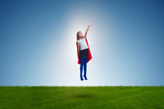 The superhero kid flying in dream concept Stock Images