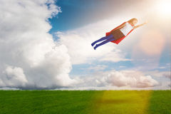 The superhero kid flying in dream concept Royalty Free Stock Images