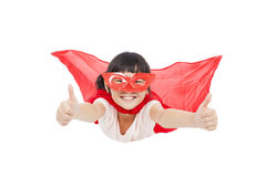 Superhero kid flying and thumb up. Stock Photography