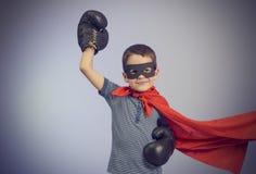 Superhero kid Stock Image