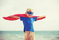 Superhero Kid. Young Happy Boy Playing Royalty Free Stock Photo