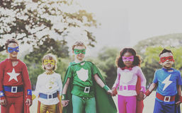 Superhero Kids Aspirations Fun Outdoors Concept.  stock photos