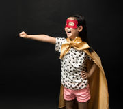 Superhero kids on a black background. Fly Super Hero stock image
