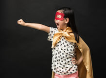 Superhero kids on a black background. Fly Super Hero royalty free stock image