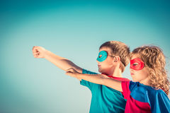 Superhero kids. Superhero children against summer sky background. Kids having fun outdoors. Boy and girl playing. Success and winner concept Royalty Free Stock Photos