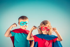 Superhero kids. Superhero children against summer sky background. Kids having fun outdoors. Boy and girl playing. Success and winner concept royalty free stock images