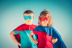 Superhero kids. Superhero children against summer sky background. Kids having fun outdoors. Boy and girl playing. Success and winner concept royalty free stock photo