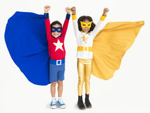 Superhero Kids Hands Up Flying Concept. Happy Kids Superhero Costume Concept royalty free stock photo