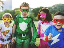 Superhero kids with superpowers diversity. Outdoor stock photo