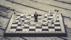 The Superhero Landing. The Superhero lands on the chess board to fight his enemies Stock Photo