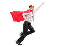 Superhero launching into the air Stock Photos
