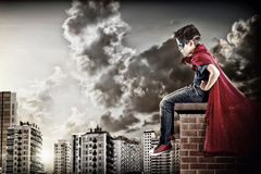 Superhero. Little boy pretending to be a superhero stock image