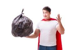 The superhero man with garbage sack isolated on white Stock Image