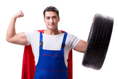 The superhero man with tyre isolated white background Stock Image