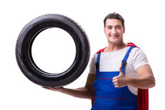 The superhero man with tyre isolated white background Stock Photo