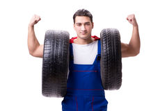 The superhero man with tyre isolated white background. Superhero man with tyre isolated white background Stock Images