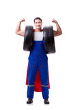 The superhero man with tyre isolated white background Stock Photos