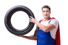 The superhero man with tyre isolated white background Royalty Free Stock Photo