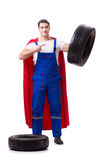The superhero man with tyre isolated white background. Superhero man with tyre isolated white background Royalty Free Stock Photography