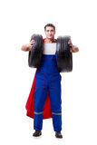 The superhero man with tyre isolated white background Royalty Free Stock Photography