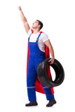 The superhero man with tyre isolated white background. Superhero man with tyre isolated white background Stock Image