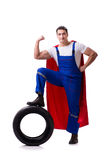 The superhero man with tyre isolated white background Stock Images