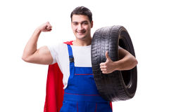The superhero man with tyre isolated white background Royalty Free Stock Image