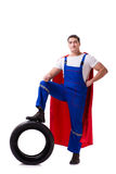 The superhero man with tyre isolated white background. Superhero man with tyre isolated white background Royalty Free Stock Image