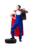 The superhero man with tyre isolated white background. Superhero man with tyre isolated white background Stock Photo