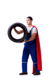 The superhero man with tyre isolated white background. Superhero man with tyre isolated white background Royalty Free Stock Photos