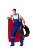 The superhero man with tyre isolated white background. Superhero man with tyre isolated white background Royalty Free Stock Images