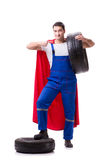 The superhero man with tyre isolated white background Royalty Free Stock Photos