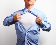 Superhero. Mature Businessman Tearing His Shirt Off Over White B Royalty Free Stock Images
