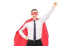 Superhero med den lyftta näven Royaltyfria Bilder